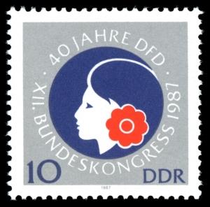 """Briefmarke von 1987 zum Jubiläum """"40 Jahre DFD"""" Bildquelle: """"Stamps of Germany (DDR) 1987, MiNr 3079"""" von Hochgeladen und Bearbeitet von --Nightflyer (talk) 21:33, 1 March 2011 (UTC) - Eigener Scan. Lizenziert unter Gemeinfrei über Wikimedia Commons -"""
